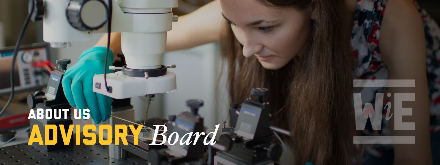 WiE About Us: Advisory Board. An engineering student works in the lab using a microscope.