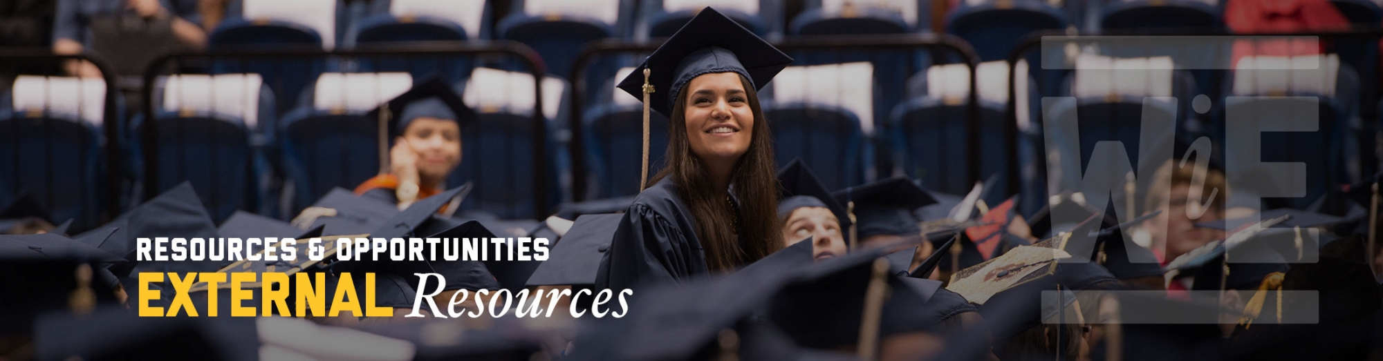 WiE External Resources. A SEAS graduate wearing cap and gown smiles during commencement ceremonies.